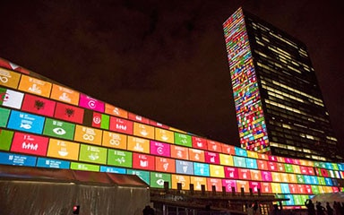 SDG icons projected on the UN Headquarters in New York © UN Photo / Cia Pak