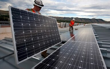 Workers are installing solar panels.