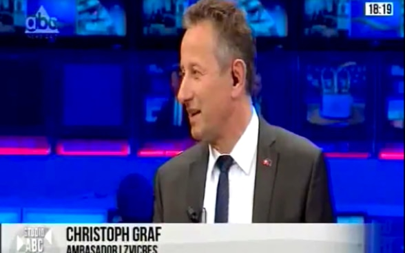 Swiss Ambassador in Albania Christoph Graf talking about decentralisation at ABC News television