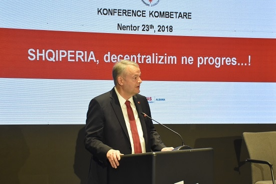 Swiss Ambassador Adrian Maître addressing the conference on decentralisation in Albania
