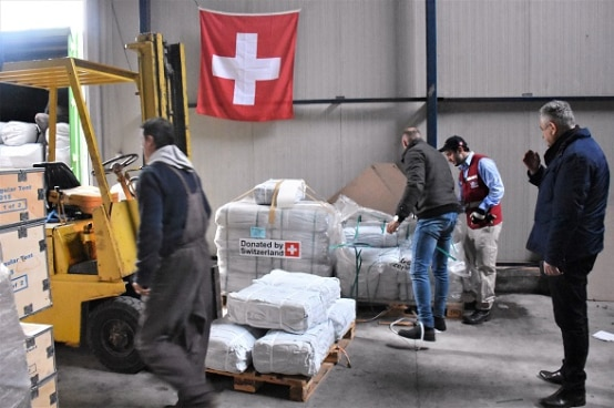 Swiss humanitarian mission delivering supplies in Lezhë, Albania.