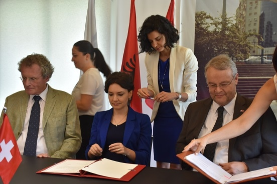Signing of agreement in support of Albania's Parliament. From left: Head of OSCE Presence in Albania, Bernd Borchardt; Minister for Relations with Parliament Elisa Spiropali; Swiss Ambassador in Albania Adrian Maître.