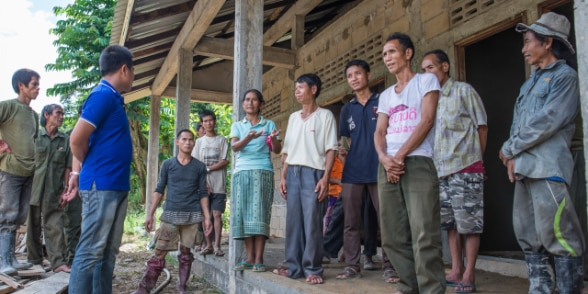 Villagers, local authorities and project staff discuss new primary school construction progress in Luang Prabang, Lao PDR.