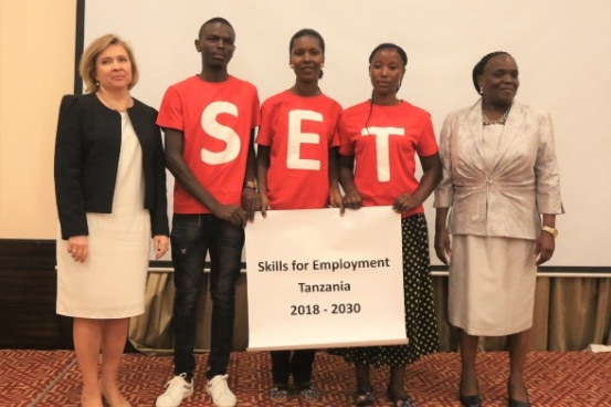 From left: Swiss Ambassador Florence Tinguely Mattli, youth from the Swiss-funded OYE project and Minister for Education Prof. Joyce Ndalichako at the SET launch.