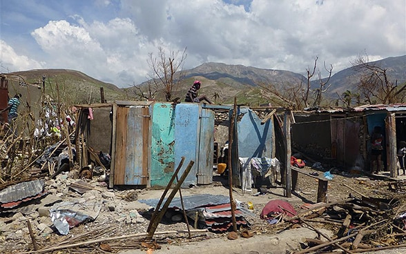 Makeshift homes damaged by Hurricane Matthew in Haiti.
