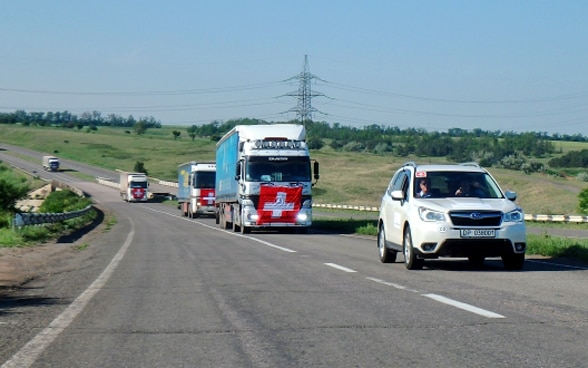 Trucks with Swiss flags on the bonnet roar through the Ukrainian steppe.