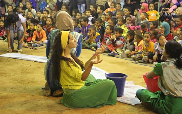 A woman performs in a play for schoolchildren about water, in the Egyptian city of Aswan.