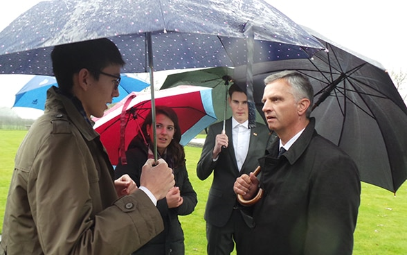 "The President of the Swiss Confederation, Didier Burkhalter, talking with Swiss school pupils at the ""Hill 62"" First World War trench near Ypres in West Flanders (Belgium)"