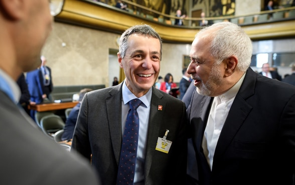 Federal Councillor Ignazio Cassis speaks with Iranian Foreign Minister Mohammad Javad Zarif