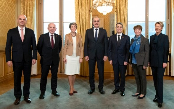 The newly elected Federal Councillors Karin Keller-Sutter, right, and Viola Amherd, 2second from right, pose with the entire Federal Council, from left, Alain Berset, Ueli Maurer, Simonetta Sommaruga, Guy Parmelin and Ignazio Cassis.