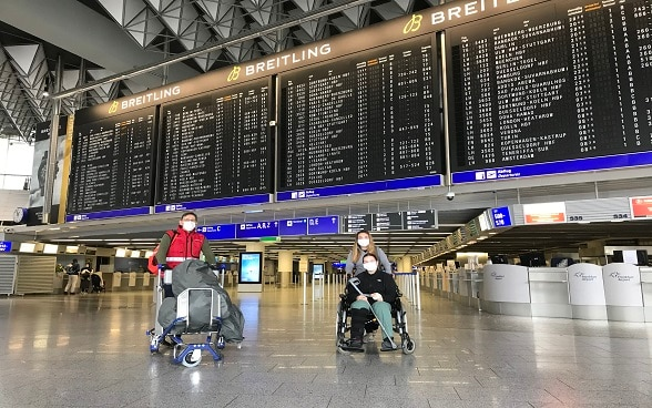 Three Swiss citizens are photographed at Frankfurt airport after boarding in Kathmandu.