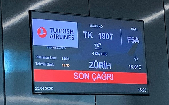 A screen in the departure lounge of Istanbul Airport displays Zurich as the flight destination.