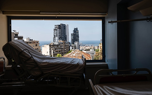 View of a maternity bed with view out of the window on the destroyed capital of Lebanon.