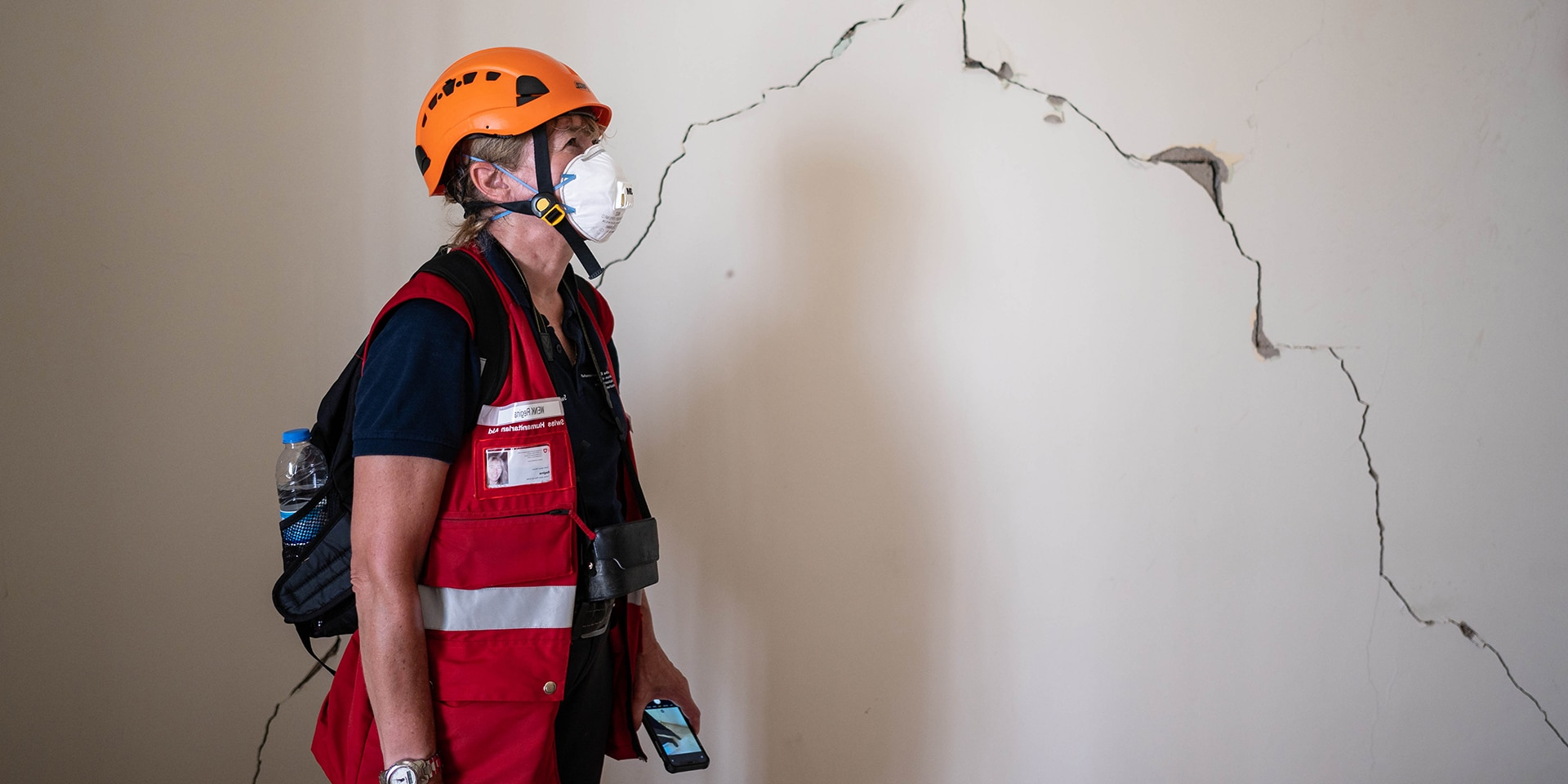 Engineer Regina Wenk examines a damaged wall for its stability.