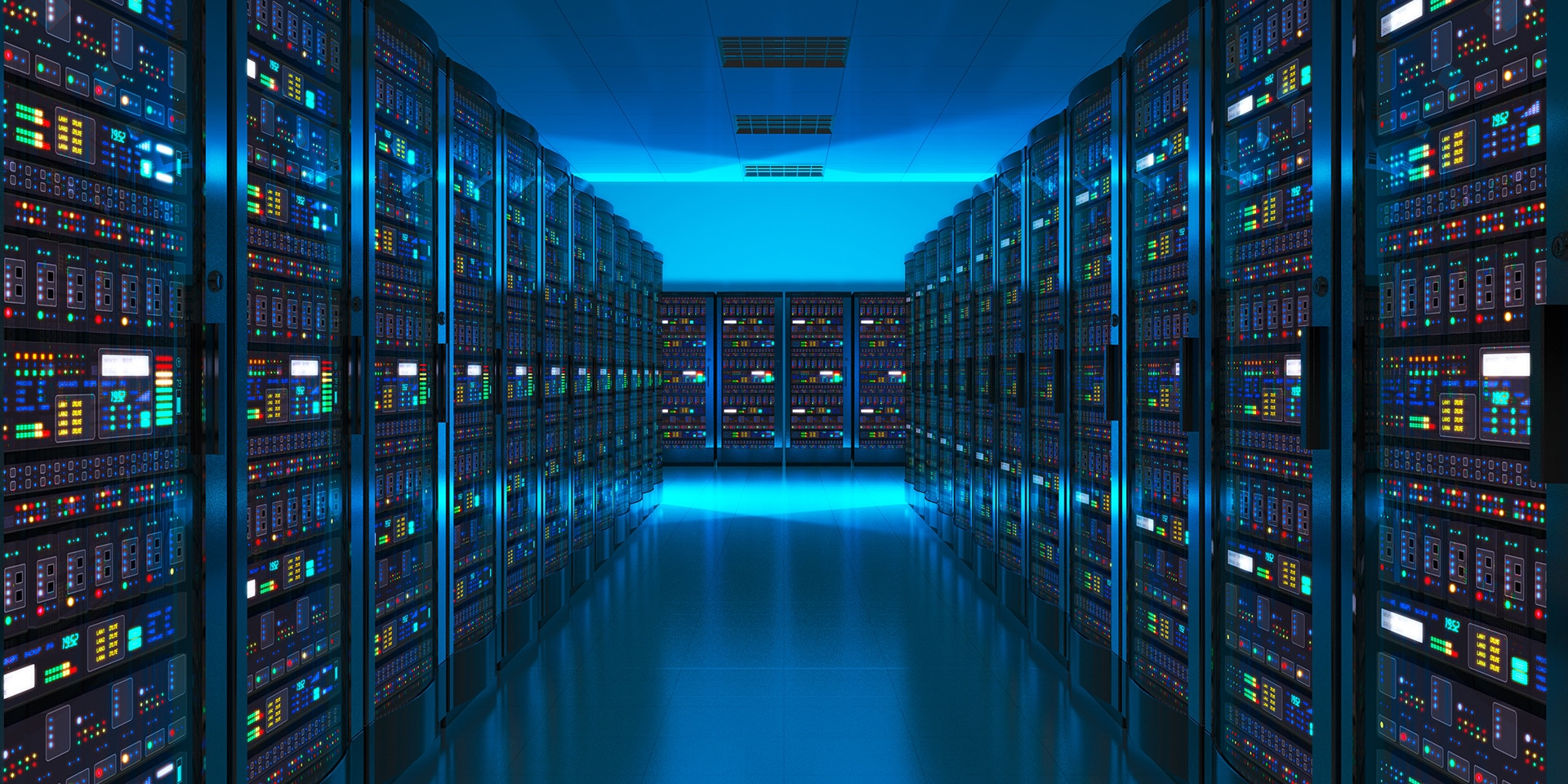 We see a darkened room with a blue glow containing rows of servers on which digital data is stored.