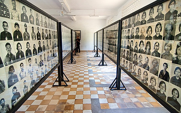 Black and white photographs of torture victims in the Tuol Sleng Genocide Museum in Phnom Penh in Cambodia.