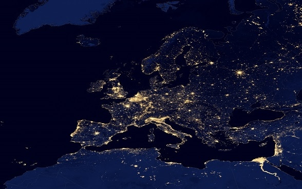 Satellite image of Europe at night, the number of lights reflecting different population densities.