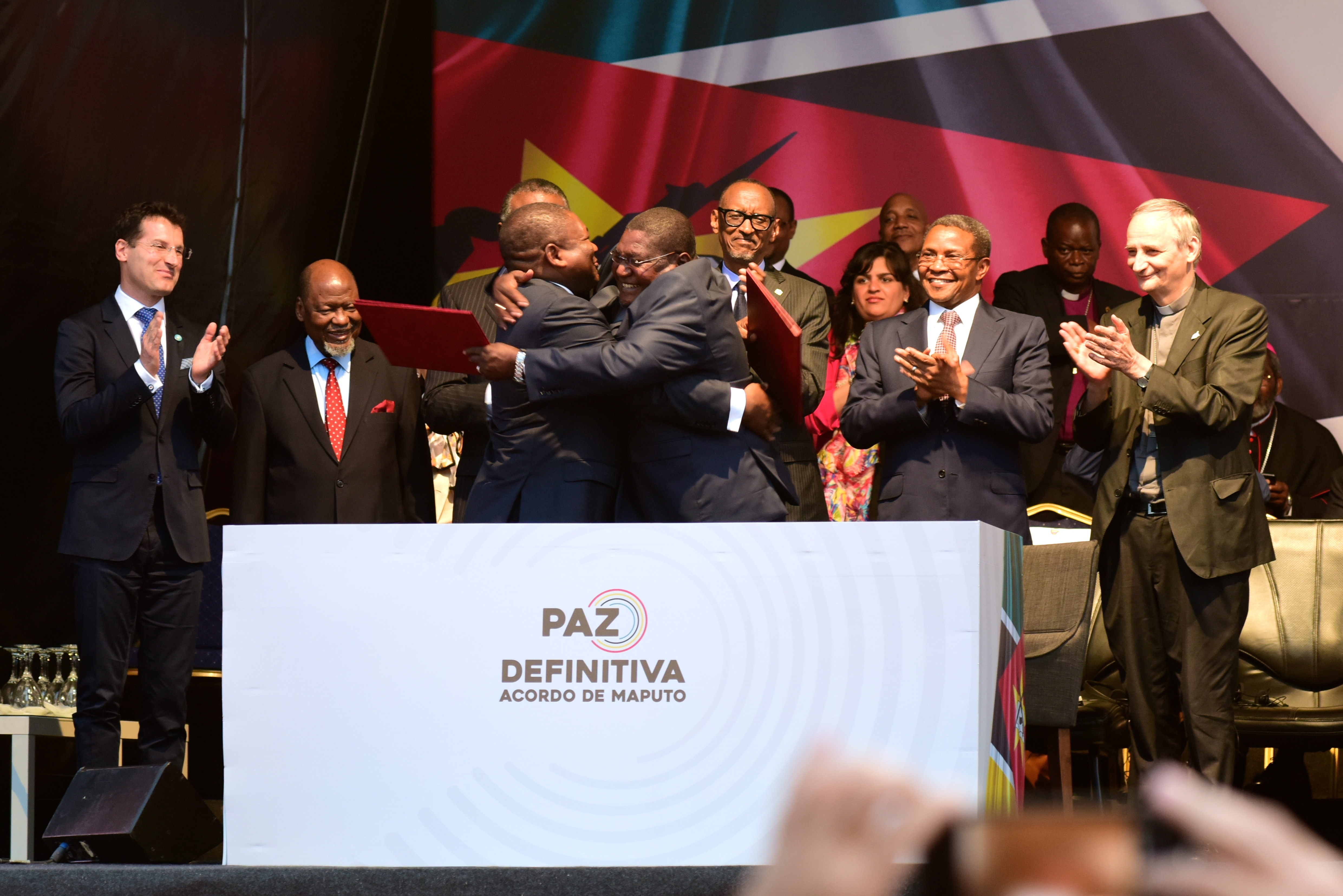 Mozambique's President Nyusi and the leader of the former rebel group Renamo (Ossufo Momade) embrace at the ceremony to mark the signing of the peace accord following decades of violence.