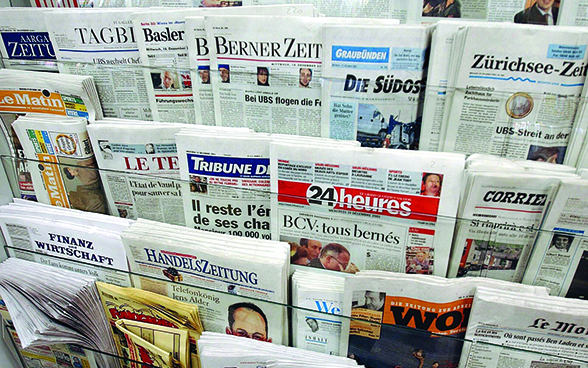 Different newspapers at a newspaper stand