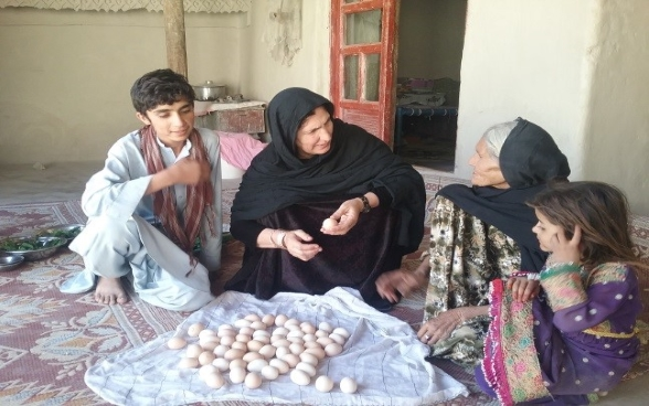 A woman-headed family involved in poultry and egg production