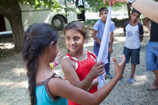 Roma young girls participating in games at summer camps organised by Swiss-supported project.