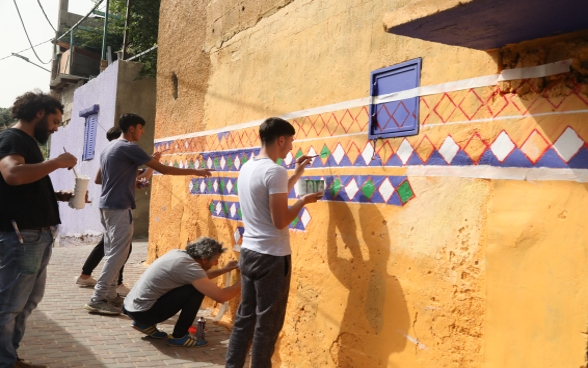 Qattana local community members are beautifying their village through repairing and painting the walls
