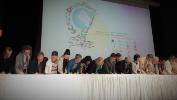 Ambassador Beatrice Maser Mallor (the 4th from the left), together with the 40 international partners, signing the Code of Conduct