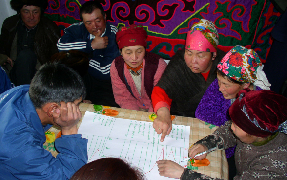 The local community discusses health priorities within their village.