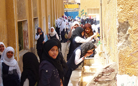 Girls at a secondary school in Aswan drink water from taps installed in the schoolyard.