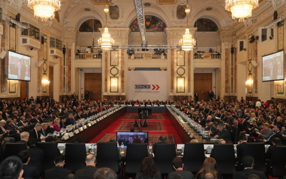 Ministers of the OSCE's participating States are reunited in a hall for the plenary Assembly in Vienna.