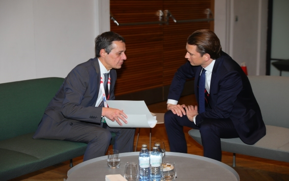 Federal Councilor Ignazio Cassis sits and talks with Sebastian Kurz, Austrian Foreign Minister.